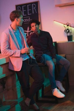 multiethnic men having conversation in bar
