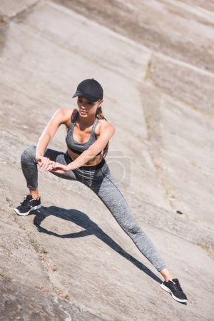 Woman stretching on slabs