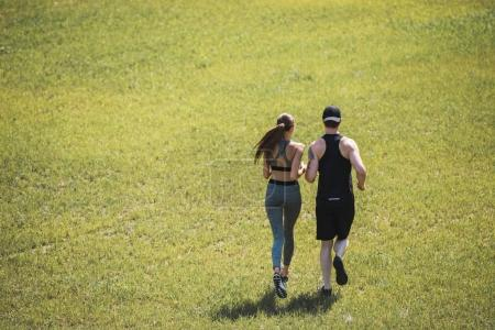 couple jogging in park