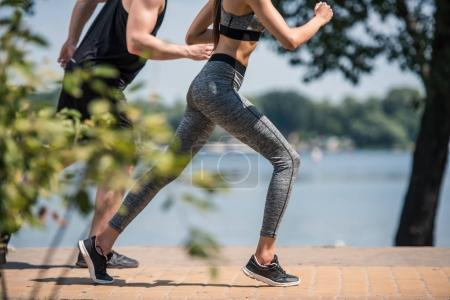 sportive couple jogging in park