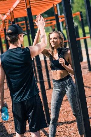 Woman giving high five to trainer