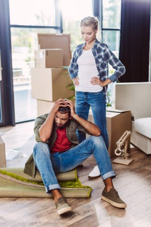 young couple in new apartment
