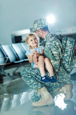 daughter meeting father at airport