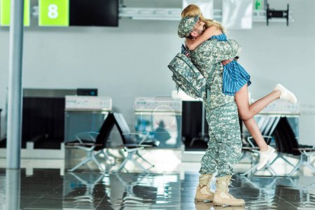 wife meeting soldier at airport