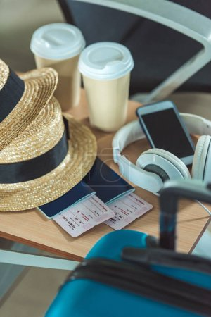 Photo for Close up view of hats, smartphone, headphones, passports and tickets - Royalty Free Image