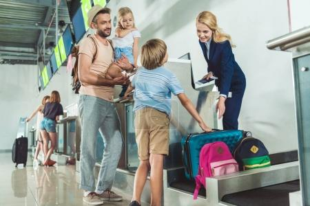 Family at check in desk in airport