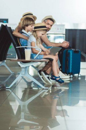 kid with tablet at airport