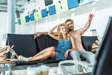 couple waiting for boarding at airport