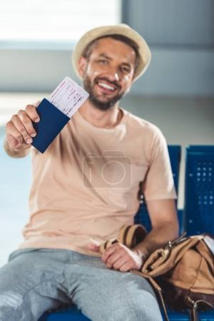 Tourist showing passport and ticket