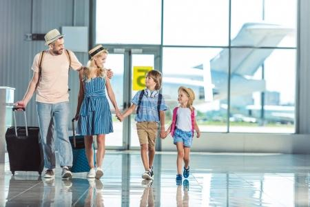 family walking in airport