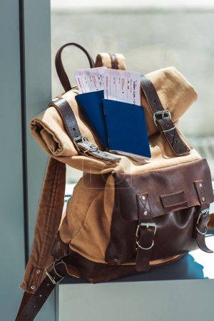 Photo for Close up view of backpack, passports and tickets on airport windowsill - Royalty Free Image