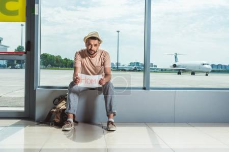 Tourist with card in airport
