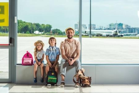Father and kids waiting for boarding