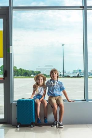 Siblings waiting in airport