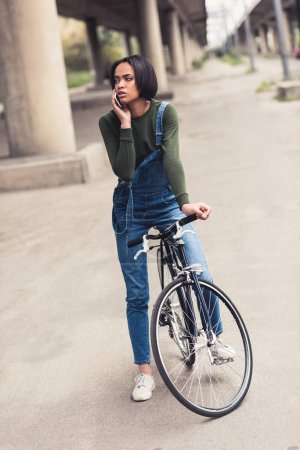 woman on bicycle talking by phone