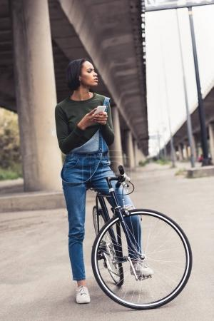woman on bicycle with smartphone