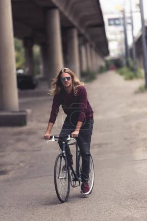 Man riding vintage bicycle