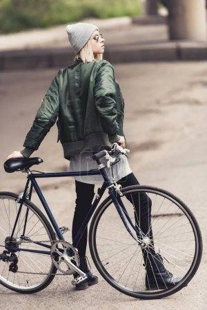 woman with vintage bicycle
