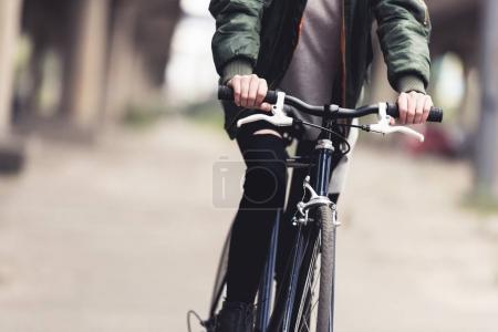 woman riding vintage bicycle