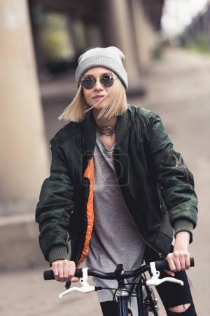 Photo for Stylish young beautiful woman riding vintage bicycle - Royalty Free Image