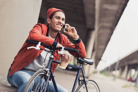 man with bicycle talking by phone