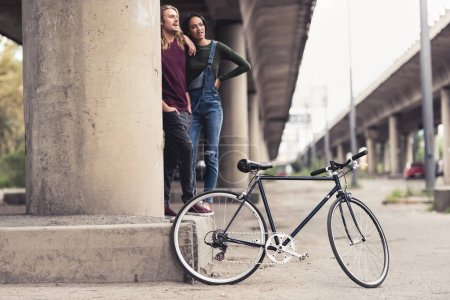 couple with vintage bicycle