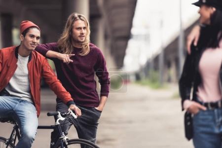 men flirting with woman passing by