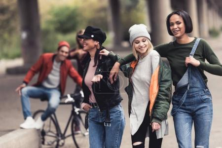 stylish women walking outdoors