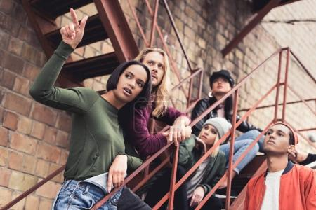 stylish young people on stairs