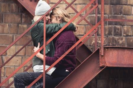 couple sitting on stairs and embracing