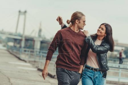 Photo for Beautiful young couple walking outdoors by industrial district - Royalty Free Image