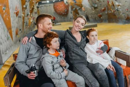 Family with kids at gym