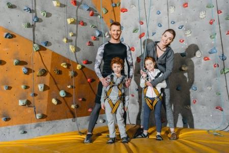 Family standing near climbing walls