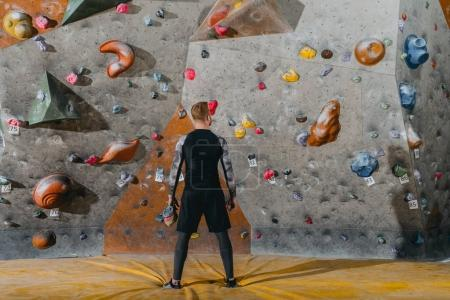 Photo for Full-length shot of a young man in sportive attire posing in front of climbing wall - Royalty Free Image