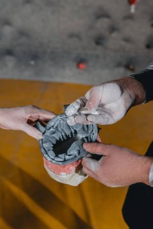 man applying talcum powder hands