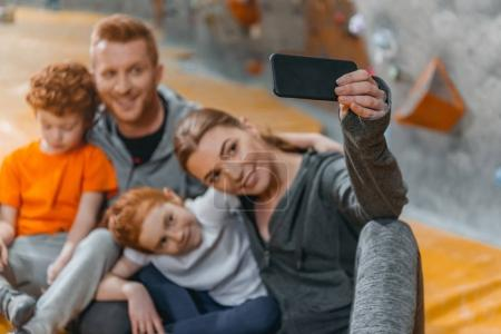 Family taking selfie at gym