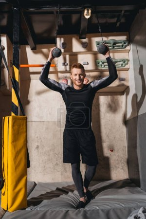 Young man with kettlebells