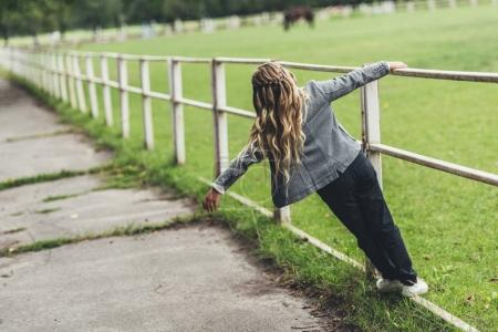 child walking at fence