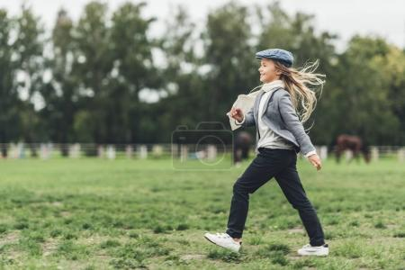 Photo for Happy adorable blonde child running at countryside - Royalty Free Image