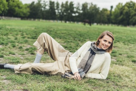 woman lying on grass at countryside