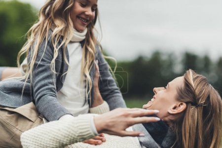 Photo for Happy stylish mother and daughter having fun together - Royalty Free Image