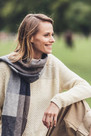 woman in autumn outfit at countryside