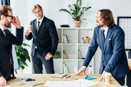 Photo for Professional handsome middle aged businessmen working together in office - Royalty Free Image