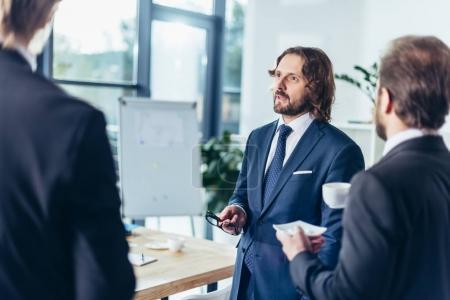 businessmen talking in office