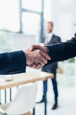 Photo for Close-up partial view of businessmen shaking hands - Royalty Free Image