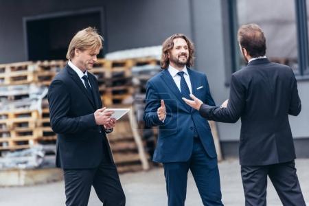 Businessmen working with digital tablet