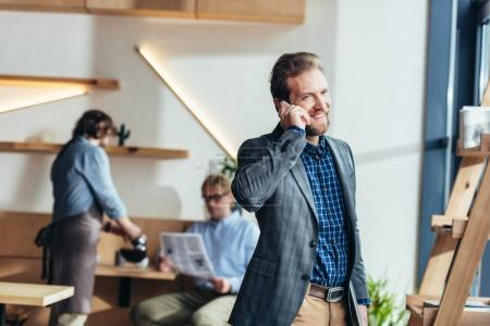 businessman talking on smartphone
