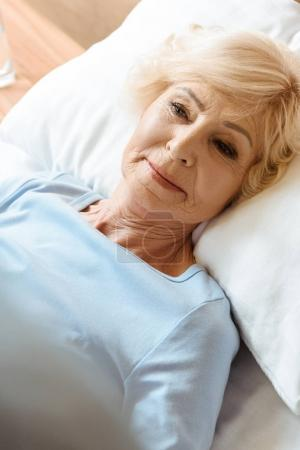 Senior woman in hospital bed