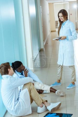 doctors sitting in hospital corridor