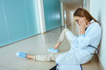 doctor sitting in hospital corridor